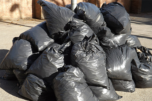 Pile of Black Garbage Trash Bags