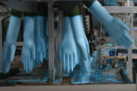 Glove Formers Being Dipped